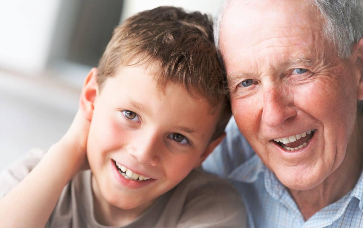 Bonding - Closeup portrait of a happy old man with adorable grandson