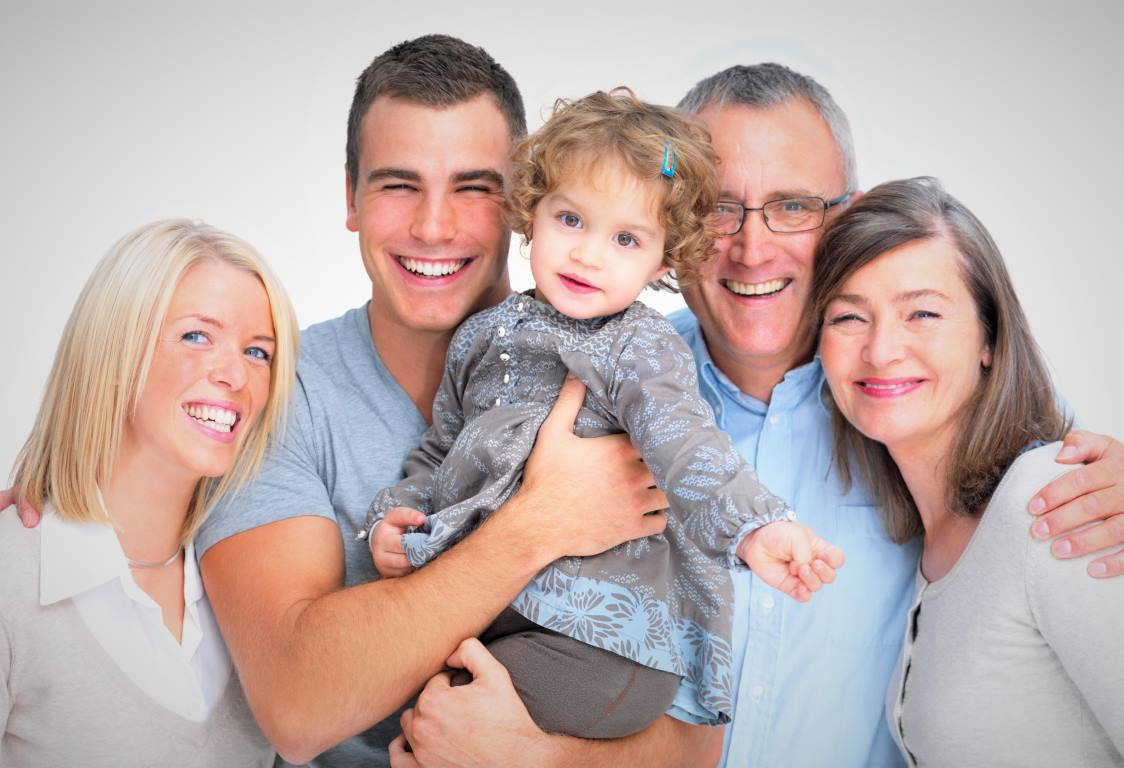 Closeup portrait of a happy family standing together isolated on white background
